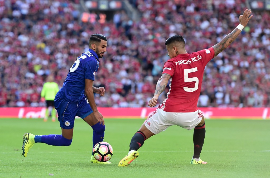 LONDON, ENGLAND - AUGUST 07: Riyad Mahrez of Leicester City takes the ball past Marcos Rojo of Manchester United during The FA Community Shield match between Leicester City and Manchester United at Wembley Stadium on August 7, 2016 in London, England. (Photo by Alex Broadway/Getty Images)