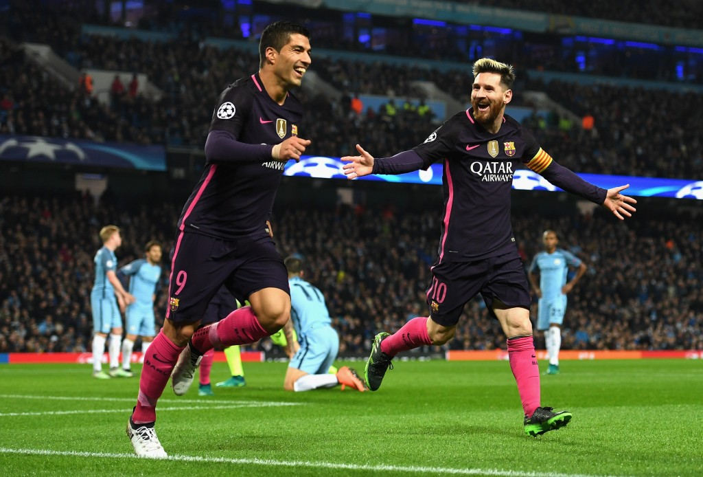 MANCHESTER, ENGLAND - NOVEMBER 01: Lionel Messi of Barcelona (R) celebrates scoring his sides first goal with Luis Suarez of Barcelona (L) during the UEFA Champions League Group C match between Manchester City FC and FC Barcelona at Etihad Stadium on November 1, 2016 in Manchester, England. (Photo by Shaun Botterill/Getty Images)