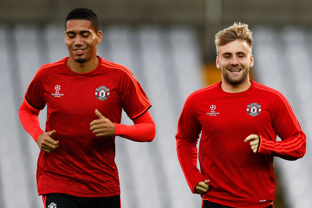 BRUGGE, BELGIUM - AUGUST 25: Chris Smalling and Luke Shaw of Manchester United warm up during the Manchester United training session held at Jan Breydel Stadium on August 25, 2015 in Brugge, Belgium. (Photo by Dean Mouhtaropoulos/Getty Images)
