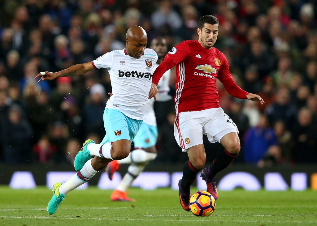 MANCHESTER, ENGLAND - NOVEMBER 27: Andre Ayew of West Ham United (L) and Henrikh Mkhitaryan of Manchester United (R) battle for possession during the Premier League match between Manchester United and West Ham United at Old Trafford on November 27, 2016 in Manchester, England. (Photo by Alex Livesey/Getty Images)