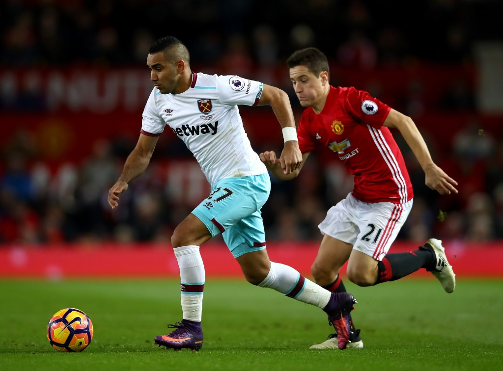 MANCHESTER, ENGLAND - NOVEMBER 27: Dimitri Payet of West Ham United (L) takes the ball past Ander Herrera of Manchester United (R) during the Premier League match between Manchester United and West Ham United at Old Trafford on November 27, 2016 in Manchester, England. (Photo by Clive Brunskill/Getty Images)