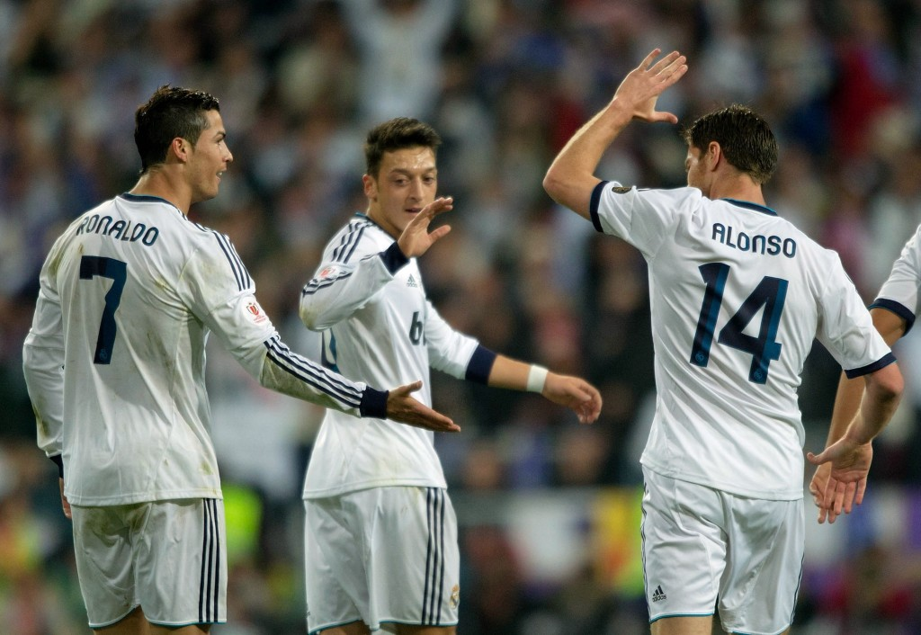 MADRID, SPAIN - MAY 17: Cristiano Ronaldo (L) of Real Madrid CF celebrates with teammates Mesut Ozil (C) and Xabi Alonso (R) after scoring the opening goal during the Copa del Rey Final match between Real Madrid CF and Club Atletico de Madrid at Estadio Santiago Bernabeu on May 17, 2013 in Madrid, Spain. (Photo by Gonzalo Arroyo/Getty Images)