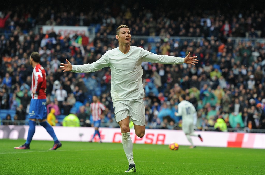MADRID, SPAIN - NOVEMBER 26: Cristiano Ronaldo of Real Madrid celebrates after scoring Real's 2nd goal from during the La Liga match between Real Madrid CF and Real Sporting de Gijon at Estadio Santiago Bernabeu on November 26, 2016 in Madrid, Spain. (Photo by Denis Doyle/Getty Images)