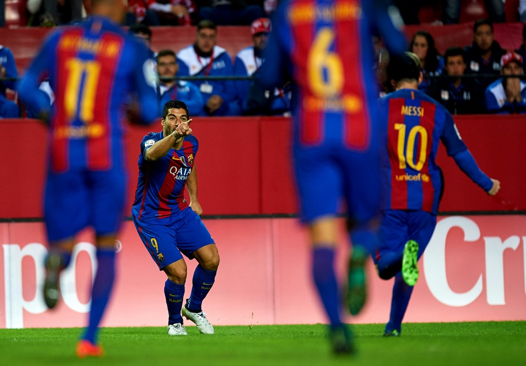 Barcelona held at home by nine-man Malaga