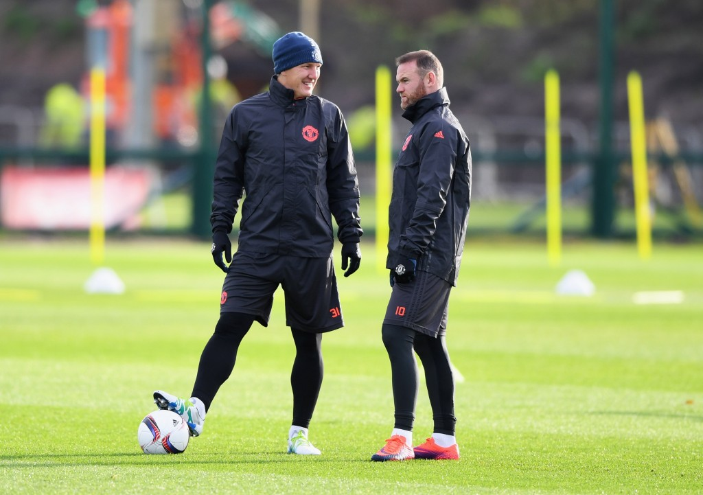 MANCHESTER, ENGLAND - NOVEMBER 23:  Wayne Rooney and Bastian Schweinsteiger in discussion during a Manchester United training session on the eve of their UEFA Europa League match against Feyenoord at Aon Training Complex on November 23, 2016 in Manchester, England.  (Photo by Gareth Copley/Getty Images)