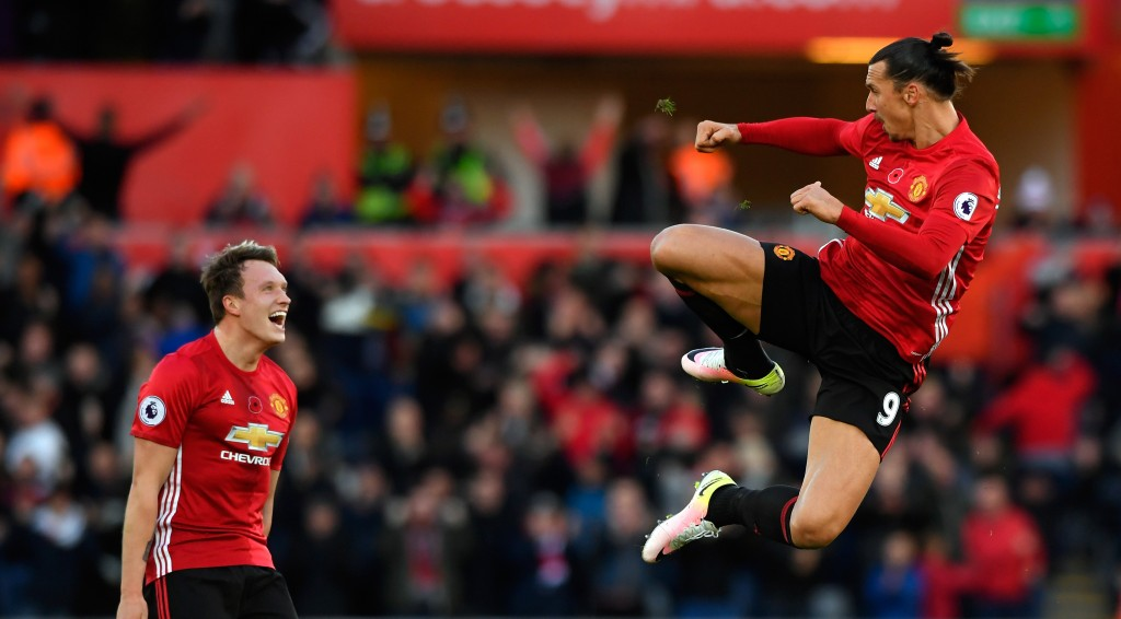 SWANSEA, WALES - NOVEMBER 06: : Zlatan Ibrahimovic of Manchester United celebrates scoring his sides second goal with Phil Jones (l) during the Premier League match between Swansea City and Manchester United at Liberty Stadium on November 6, 2016 in Swansea, Wales. (Photo by Stu Forster/Getty Images)