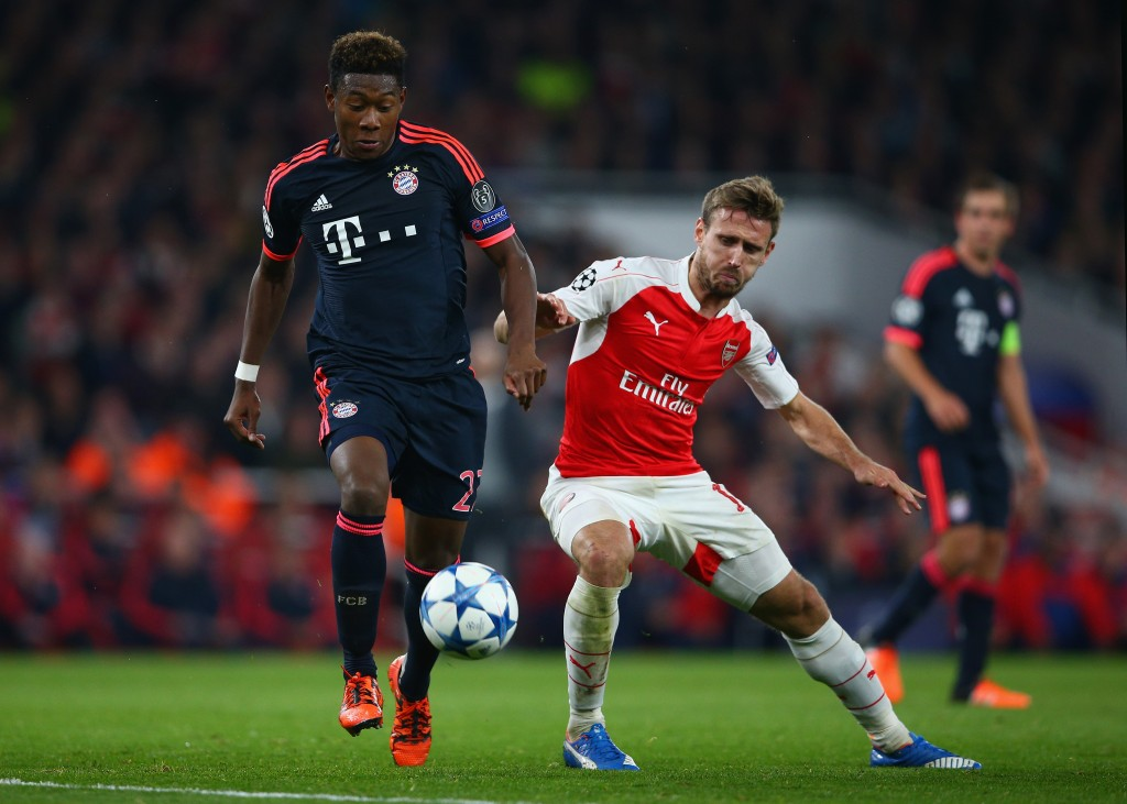 LONDON, ENGLAND - OCTOBER 20: David Alaba of Bayern Munich evades Nacho Monreal of Arsenal during the UEFA Champions League Group F match between Arsenal FC and FC Bayern Munchen at Emirates Stadium on October 20, 2015 in London, United Kingdom. (Photo by Paul Gilham/Getty Images)