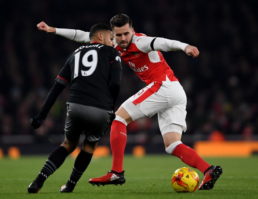 LONDON, ENGLAND - NOVEMBER 30: Sofiane Boufal of Southampton runs at Carl Jenkinson of Arsenal during the EFL Cup quarter final match between Arsenal and Southampton at the Emirates Stadium on November 30, 2016 in London, England. (Photo by Mike Hewitt/Getty Images)