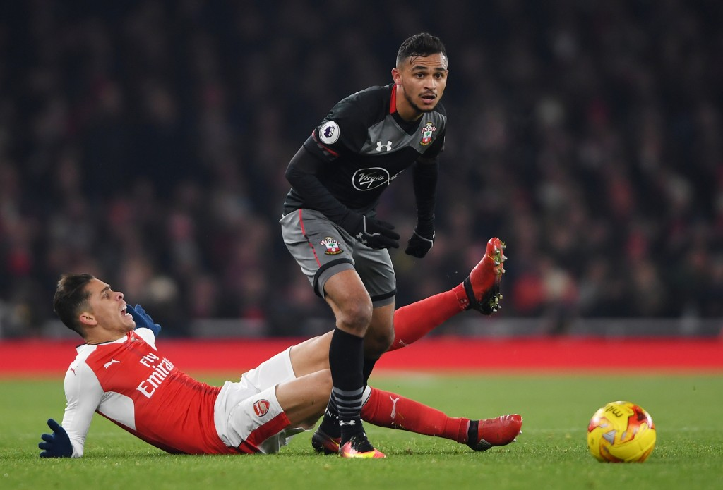 LONDON, ENGLAND - NOVEMBER 30: Sofiane Boufal of Southampton breaks clear from the tackle of Gabriel Paulista of Arsenal during the EFL Cup quarter final match between Arsenal and Southampton at the Emirates Stadium on November 30, 2016 in London, England. (Photo by Mike Hewitt/Getty Images)