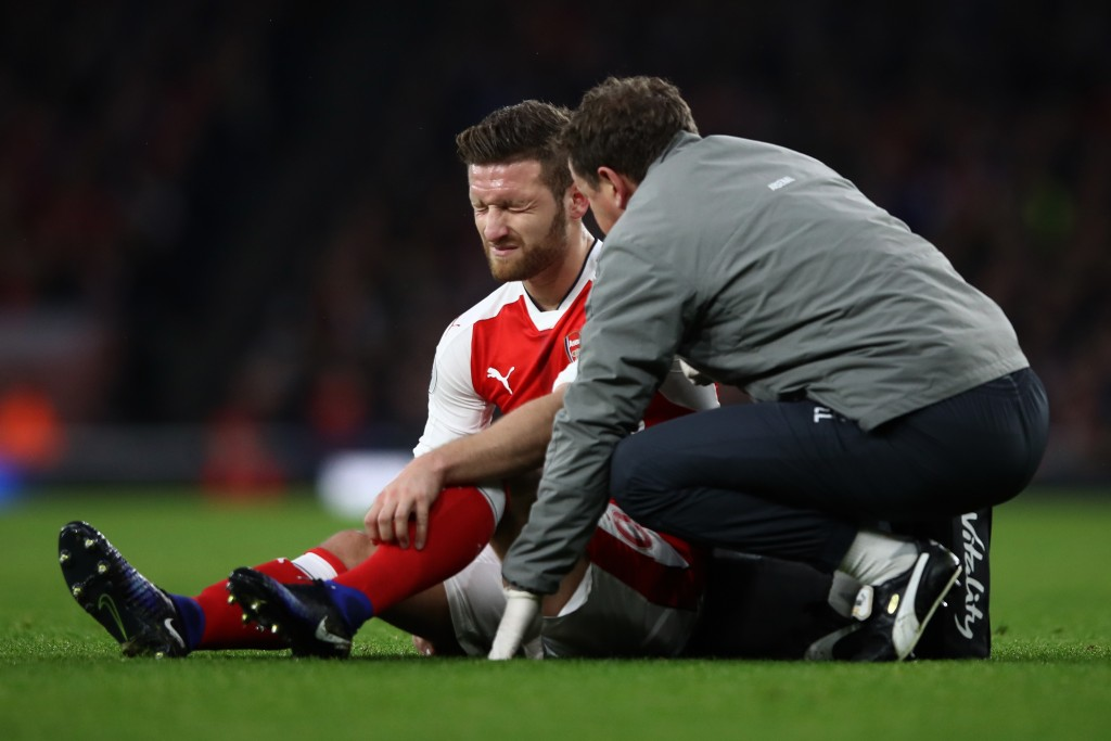 LONDON, ENGLAND - DECEMBER 10: Shkodran Mustafi of Arsenal speaks to a member of the Arsenal medical team after going down injured during the Premier League match between Arsenal and Stoke City at the Emirates Stadium on December 10, 2016 in London, England. (Photo by Julian Finney/Getty Images)