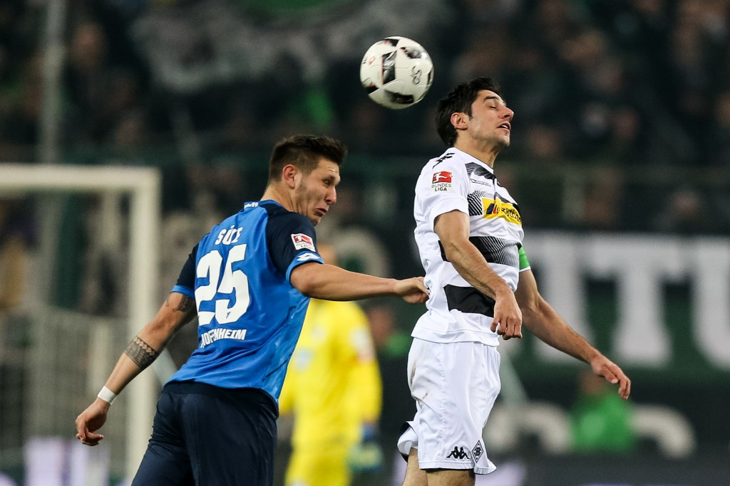 MOENCHENGLADBACH, GERMANY - NOVEMBER 26: Lars Stindl (R) of Moenchengladbach battles for the ball with Niklas Suele of Hoffenheim during the Bundesliga match between Borussia Moenchengladbach and TSG 1899 Hoffenheim at Borussia-Park on November 26, 2016 in Moenchengladbach, Germany. (Photo by Maja Hitij/Bongarts/Getty Images)