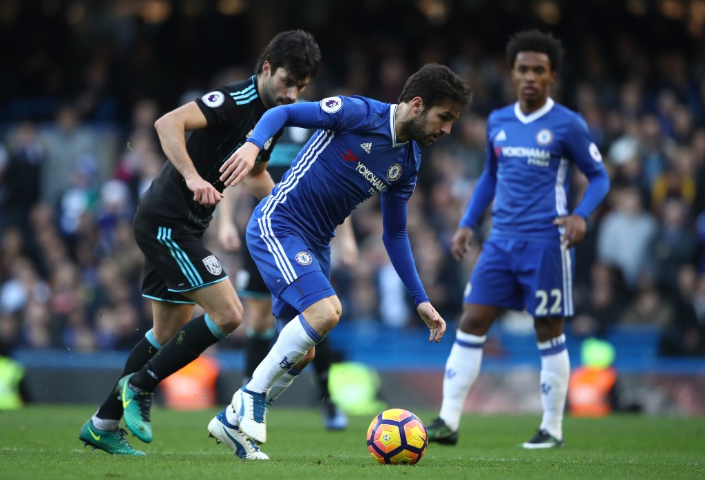 LONDON, ENGLAND - DECEMBER 11: Cesc Fabregas of Chelsea controls the ball under pressure of Claudio Yacob of West Bromwich Albion during the Premier League match between Chelsea and West Bromwich Albion at Stamford Bridge on December 11, 2016 in London, England. (Photo by Julian Finney/Getty Images)