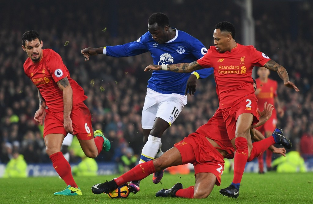 LIVERPOOL, ENGLAND - DECEMBER 19: Romelu Lukaku of Everton takes on Dejan Lovren (L), Emre Can (2R) and Nathaniel Clyne of Liverpool (R) during the Premier League match between Everton and Liverpool at Goodison Park on December 19, 2016 in Liverpool, England. (Photo by Michael Regan/Getty Images)