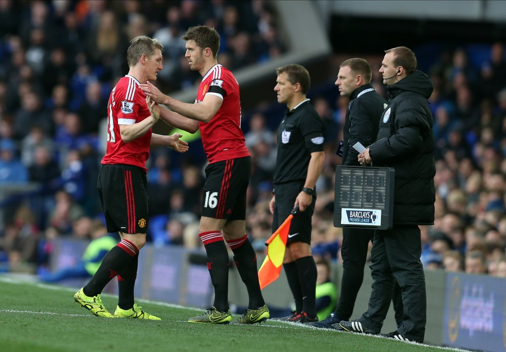 LIVERPOOL, ENGLAND - OCTOBER 17: Bastian Schweinsteiger of Manchester United is replaced by team-mate Michael Carrick during the Barclays Premier League match between Everton and Manchester United at Goodison Park on October 17, 2015 in Liverpool, England. (Photo by Chris Brunskill/Getty Images)