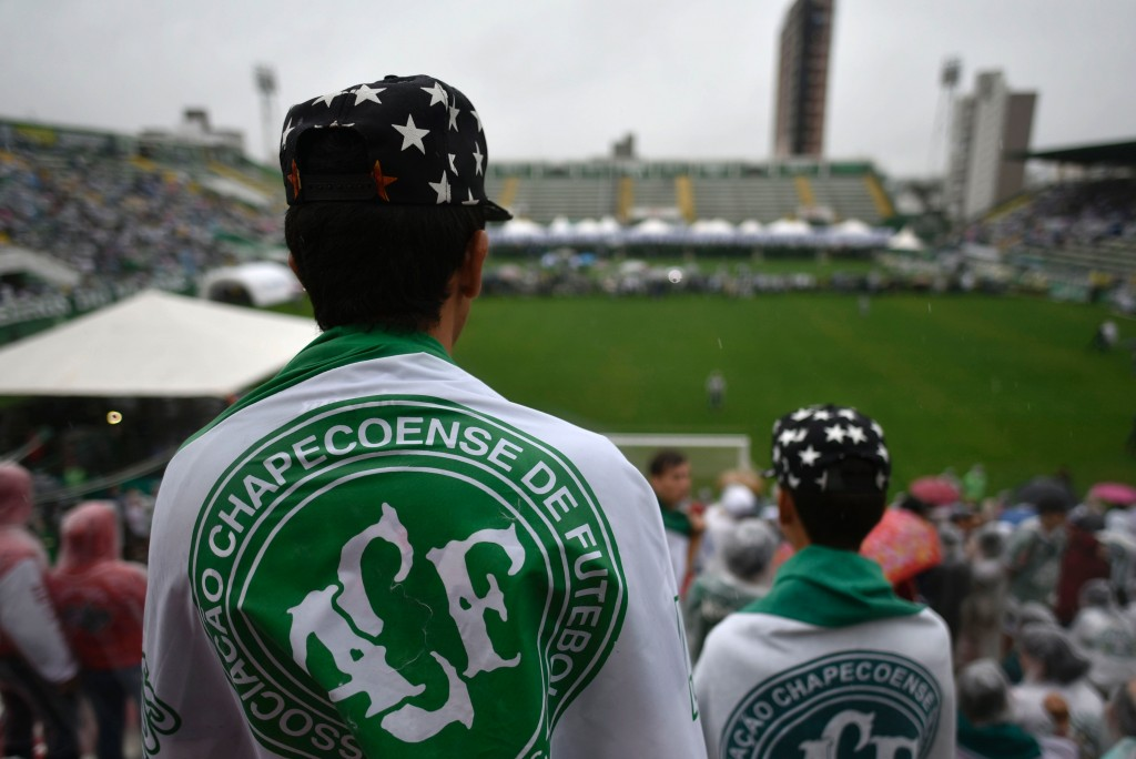 People await for the arrival of the funeral cortege of the players of Brazilian football team Chapecoense Real killed in a plane crash in the Colombian mountains, at the Arena Conda stadium in Chapeco, in the southern Brazilian state of Santa Catarina, on December 3, 2016. The first of two Brazilian air force planes carrying the remains of a football team killed in a plane crash arrived Saturday in the city of Chapeco in southern Brazil. / AFP / DOUGLAS MAGNO (Photo credit should read DOUGLAS MAGNO/AFP/Getty Images)