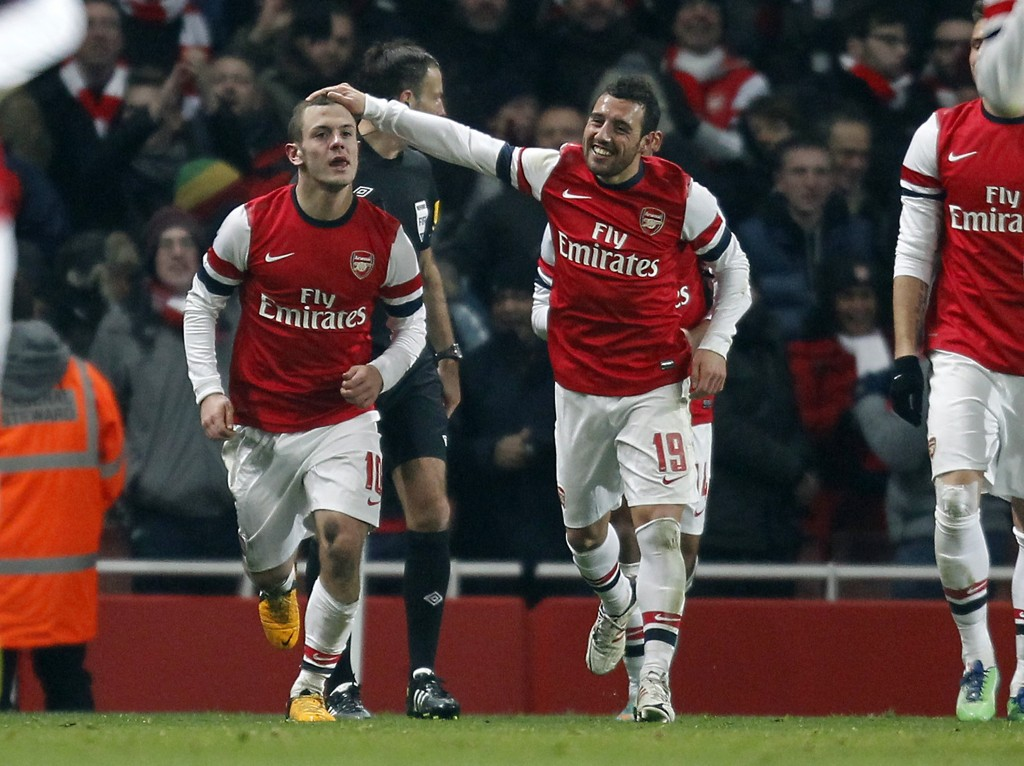 Arsenal's English midfielder Jack Wilshere (L) celebrates scoring their goal with Arsenal's Spanish midfielder Santi Cazorla (R) during the English FA Cup third round replay football match between Arsenal and Swansea City at the Emirates Stadium in London on January 16, 2013. Arsenal won the game 1-0. (Photo by Ian Kington/AFP/Getty Images)