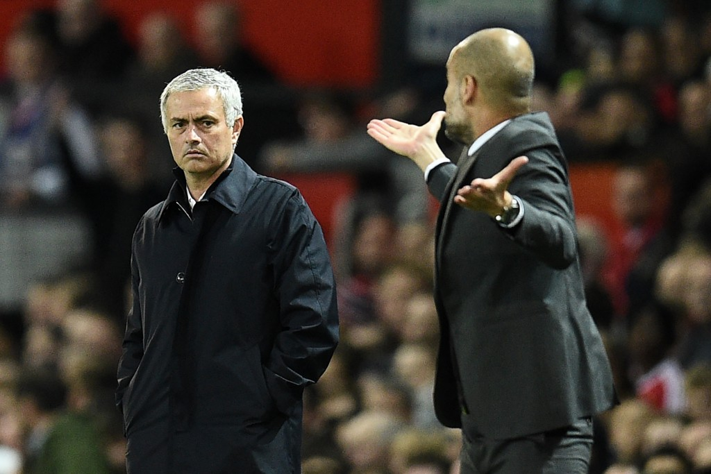 Manchester United's Portuguese manager Jose Mourinho (L) watches as Manchester City's Spanish manager Pep Guardiola gestures on the touchline during the EFL (English Football League) Cup fourth round match between Manchester United and Manchester City at Old Trafford in Manchester, north west England on October 26, 2016. (Photo by Oli Scarff/AFP/Getty Images)