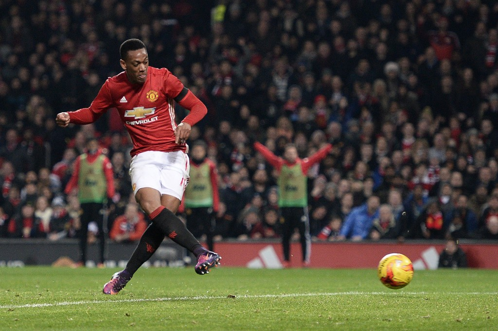 Manchester United's French striker Anthony Martial scores his team's third goal during the EFL (English Football League) Cup quarter-final football match between Manchester United and West Ham United at Old Trafford in Manchester, north west England, on November 30, 2016 (Photo by OLI SCARFF/AFP/Getty Images)