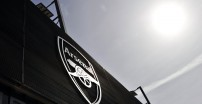 A picture shows the Arsenal logo outside the Emirates stadium before the English Premier League football match against Tottenham Hotspur in London on September 1, 2013. AFP PHOTO/GLYN KIRK  RESTRICTED TO EDITORIAL USE. No use with unauthorized audio, video, data, fixture lists, club/league logos or live services. Online in-match use limited to 45 images, no video emulation. No use in betting, games or single club/league/player publications.        (Photo credit should read GLYN KIRK/AFP/Getty Images)