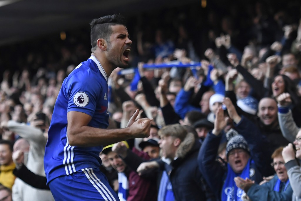 Chelsea's Brazilian-born Spanish striker Diego Costa celebrates after scoring the opening goal of the English Premier League football match between Chelsea and West Bromwich Albion at Stamford Bridge in London on December 11, 2016. (Photo by Justin Tallis/AFP/Getty Images)
