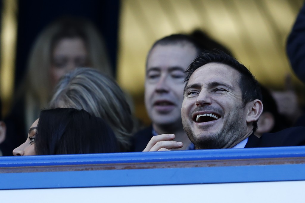 Chelsea legend Frank Lampard laughs as he awaits kick-off in the English Premier League football match between Chelsea and West Bromwich Albion at Stamford Bridge in London on December 11, 2016. / AFP / Adrian DENNIS / RESTRICTED TO EDITORIAL USE. No use with unauthorized audio, video, data, fixture lists, club/league logos or 'live' services. Online in-match use limited to 75 images, no video emulation. No use in betting, games or single club/league/player publications. / (Photo credit should read ADRIAN DENNIS/AFP/Getty Images)