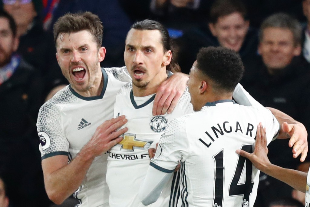 Manchester United's Swedish striker Zlatan Ibrahimovic (2L) celebrates scoring their second goal with Manchester United's English midfielder Michael Carrick (L) and Manchester United's English midfielder Jesse Lingard (R) during the English Premier League football match between Crystal Palace and Manchester United at Selhurst Park in south London on December 14, 2016. (Photo by Adrian Dennis/AFP/Getty Images)