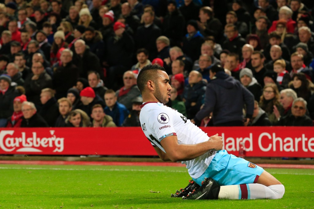 West Ham United's French midfielder Dimitri Payet celebrates after scoring their first goal during the English Premier League football match between Liverpool and West Ham United at Anfield in Liverpool, north west England on December 11, 2016. / AFP / Lindsey PARNABY / RESTRICTED TO EDITORIAL USE. No use with unauthorized audio, video, data, fixture lists, club/league logos or 'live' services. Online in-match use limited to 75 images, no video emulation. No use in betting, games or single club/league/player publications. / (Photo credit should read LINDSEY PARNABY/AFP/Getty Images)
