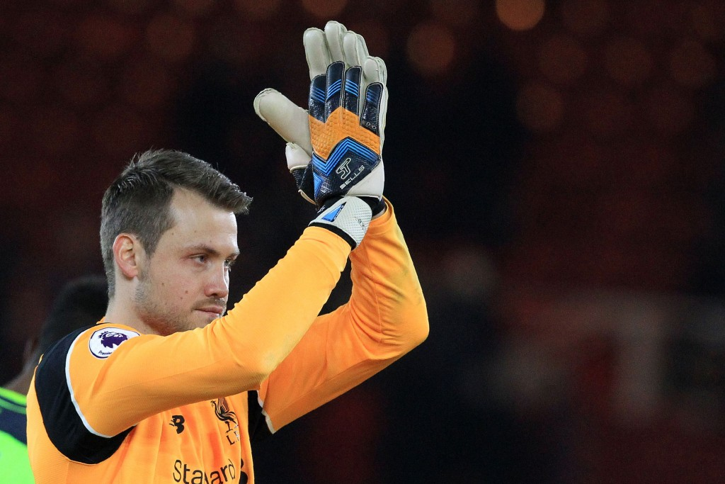 Liverpool's Belgian goalkeeper Simon Mignolet applauds the fans following the English Premier League football match between Middlesbrough and Liverpool at Riverside Stadium in Middlesbrough, northeast England on December 14, 2016. Liverpool won the match 3-0. (Photo by Lindsey Parnaby/AFP/Getty Images)