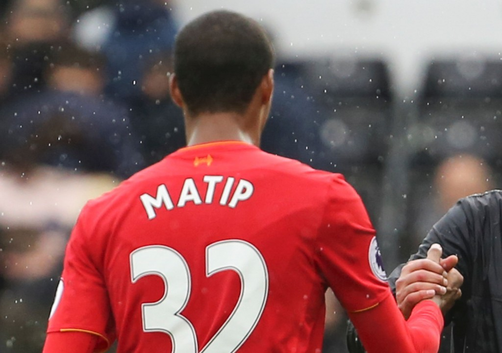 Liverpool's German manager Jurgen Klopp (R) shakes hands with Liverpool's German-born Cameroonian defender Joel Matip (L) at the end of the English Premier League football match between Swansea City and Liverpool at The Liberty Stadium in Swansea, south Wales on October 1, 2016.(Photo by Geoff Caddick/AFP/Getty Images)