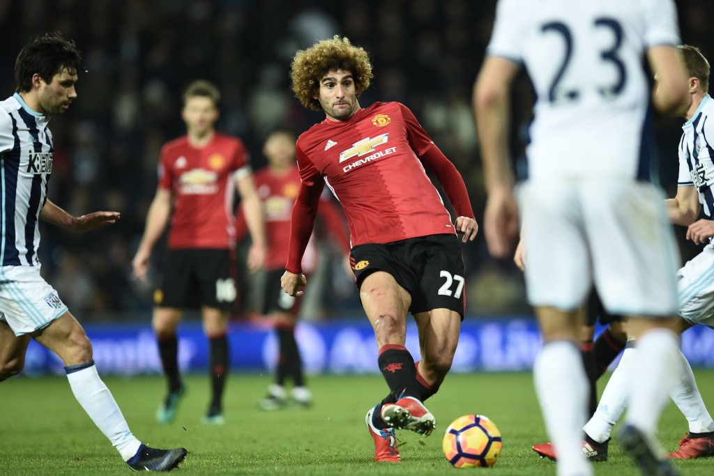 Manchester United's Belgian midfielder Marouane Fellaini passes the ball during the English Premier League football match between West Bromwich Albion and Manchester United at The Hawthorns stadium in West Bromwich, central England, on December 17, 2016. (Photo by Oli Scarff/AFP/Getty Images)