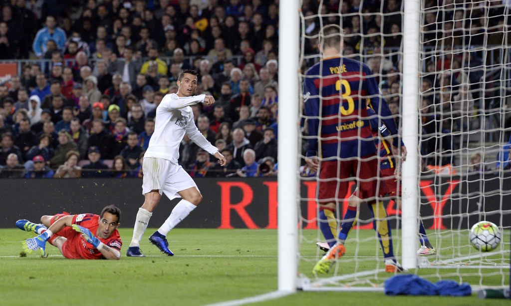 "Real Madrid's Portuguese forward Cristiano Ronaldo (L) looks at the ball after scoring a goal during the Spanish league ""Clasico"" football match FC Barcelona vs Real Madrid CF at the Camp Nou stadium in Barcelona on April 2, 2016. / AFP / JOSEP LAGO (Photo credit should read JOSEP LAGO/AFP/Getty Images)"