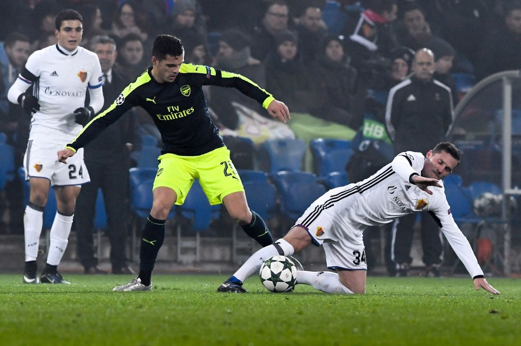 Arsenal's Swiss midfielder Granit Xhaka (C) vies with Basel's Albanian midfielder Taulant Xhaka during the UEFA Champions league Group A football match between FC Basel 1893 and Arsenal FC on December 6, 2016 at the St Jakob Park stadium in Basel. / AFP / Patrick HERTZOG (Photo credit should read PATRICK HERTZOG/AFP/Getty Images)
