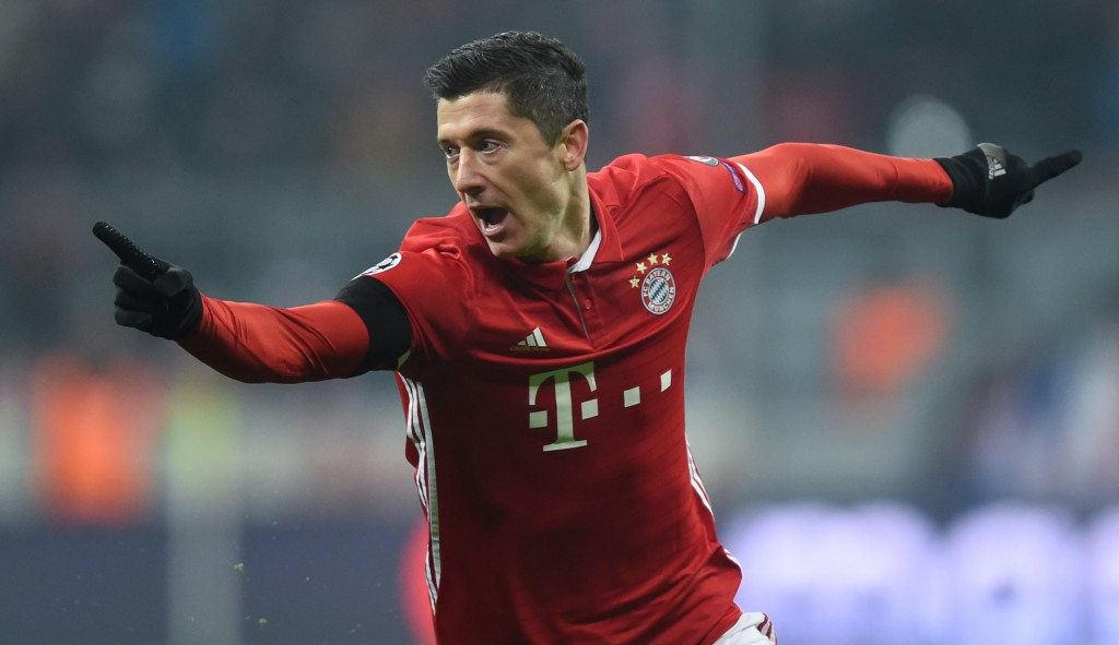 Bayern Munich's Polish striker Robert Lewandowski celebrates scoring the opening goal during the UEFA Champions League group D football match between FC Bayern Munich and Atletico Madrid in Munich, southern Germany, on December 6, 2016. / AFP / CHRISTOF STACHE (Photo credit should read CHRISTOF STACHE/AFP/Getty Images)