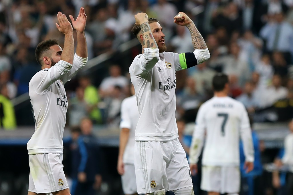 Real Madrid's defender Dani Carvajal (L) and Real Madrid's defender Sergio Ramos celebrate their victory at the end the UEFA Champions League semi-final second leg football match Real Madrid CF vs Manchester City FC at the Santiago Bernabeu stadium in Madrid, on May 4, 2016. Real Madrid won 1-0. / AFP / CESAR MANSO (Photo credit should read CESAR MANSO/AFP/Getty Images)