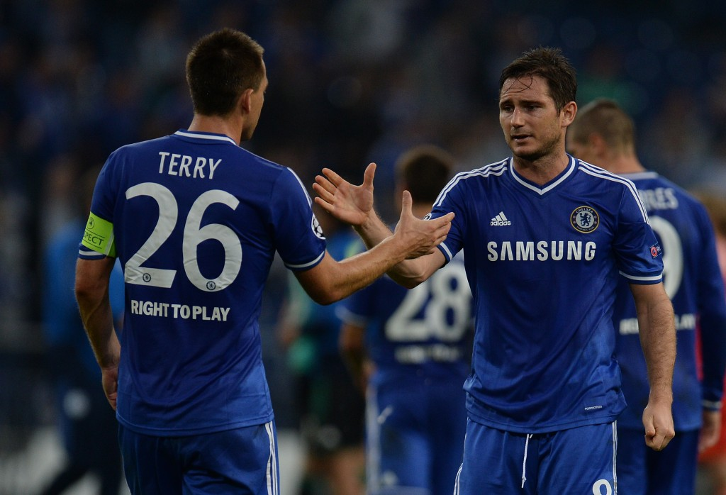 Chelsea?s defender John Terry (L) and Frank Lampard celebrate after the UEFA Champions League Group E football match Schalke 04 vs FC Chelsea in Gelsenkirchen, western Germany on October 22, 2013. AFP PHOTO / PATRIK STOLLARZ (Photo credit should read PATRIK STOLLARZ/AFP/Getty Images)
