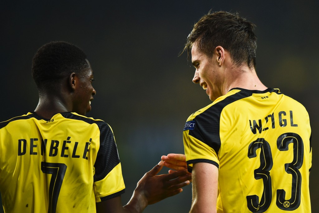 Dortmund's midfielder Julian Weigl (R) celebrates with his teammate Dortmund's French forward Ousmane Dembele (L) after scoring during the UEFA Champions League football match Sporting CP vs BVB Borussia Dortmund at the Jose Alvalade stadium in Lisbon on October 18, 2016. / AFP / PATRICIA DE MELO MOREIRA (Photo credit should read PATRICIA DE MELO MOREIRA/AFP/Getty Images)