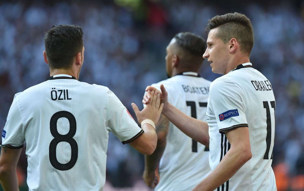 Germany's midfielder Julian Draxler (R) celebrates with Germany's midfielder Mesut Oezil after scoring during the Euro 2016 round of 16 football match between Germany and Slovakia at the Pierre-Mauroy stadium in Villeneuve-d'Ascq, near Lille, on June 26, 2016. / AFP / PHILIPPE HUGUEN (Photo credit should read PHILIPPE HUGUEN/AFP/Getty Images)