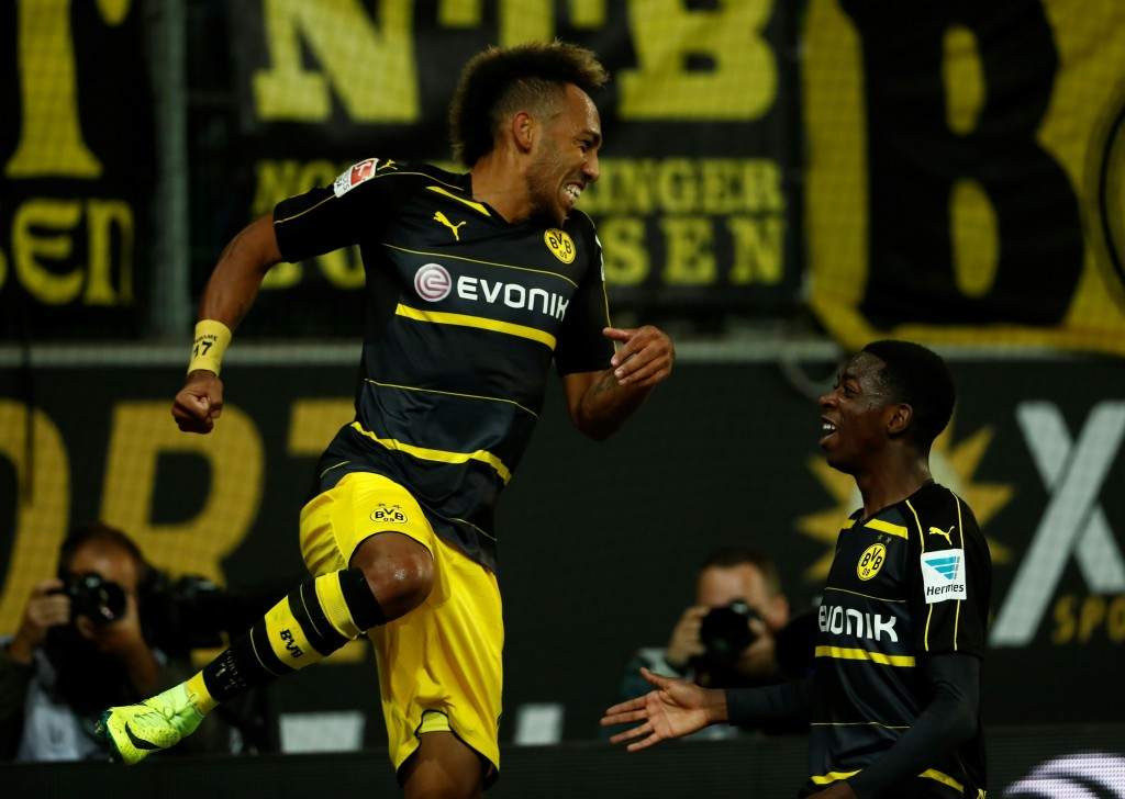 Dortmund's Gabonese forward Pierre-Emerick Aubameyang (L) and Dortmund's French midfielder Ousmane Dembele celebrate during the German first division Bundesliga football match between VfL Wolfsburg and Borussia Dortmund at Volkswagen Arena in Wolfsburg, central Germany, on September 20, 2016. / AFP / Odd ANDERSEN / RESTRICTIONS: DURING MATCH TIME: DFL RULES TO LIMIT THE ONLINE USAGE TO 15 PICTURES PER MATCH AND FORBID IMAGE SEQUENCES TO SIMULATE VIDEO. == RESTRICTED TO EDITORIAL USE == FOR FURTHER QUERIES PLEASE CONTACT DFL DIRECTLY AT + 49 69 650050 (Photo credit should read ODD ANDERSEN/AFP/Getty Images)