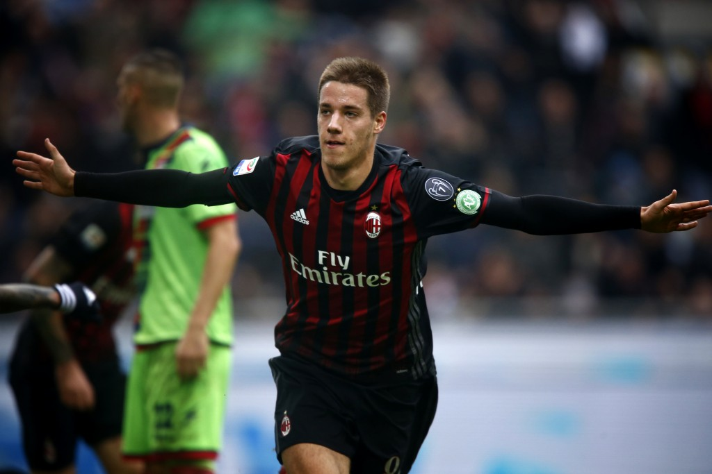 AC Milan's midfielder Mario Pasalic of Croatia celebrates after scoring during the Italian Serie A football match AC Milan Vs Crotone on December 4, 2016 at the 'San Siro Stadium' in Milan. / AFP / MARCO BERTORELLO (Photo credit should read MARCO BERTORELLO/AFP/Getty Images)