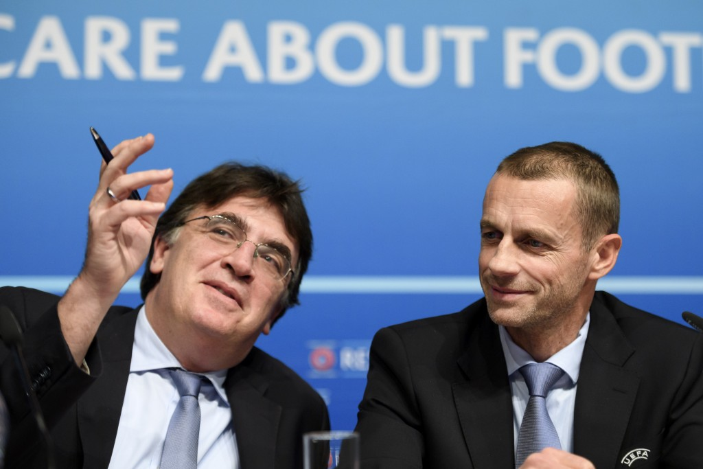 UEFA general secretary Theodore Theodoridis (L) gestures next to UEFA President Aleksander Ceferin during a press conference closing an executive meeting at the headquarters of the European football's governing body on December 9, 2016 in Nyon. / AFP / FABRICE COFFRINI (Photo credit should read FABRICE COFFRINI/AFP/Getty Images)