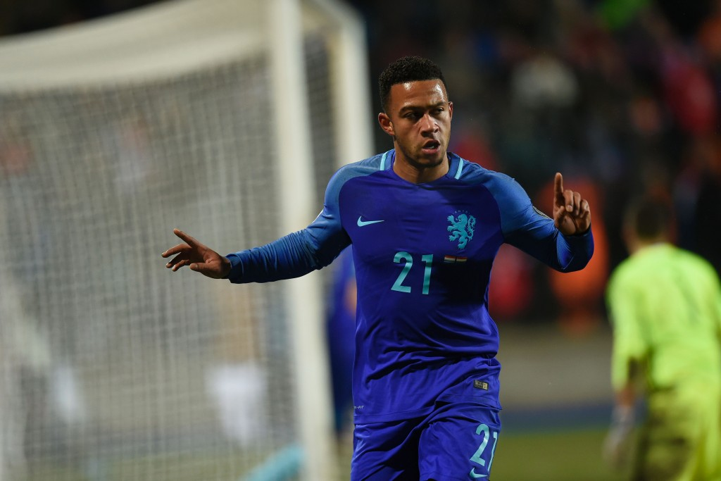 Netherlands' Memphis Depay celebrates after scoring a goal during the World Cup 2018 qualifying match between Luxembourg and Netherlands on November 13, 2016 at the Josy Barthel Stadium in Luxembourg. (Photo credit: John Thys/AFP/Getty Images)