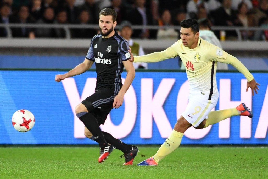 Real Madrid defender Nacho Fernandez (L) fights for the ball with Club America forward Silvio Romero (R) during the Club World Cup semi-final football match between Club America of Mexico and Real Madrid of Spain at Yokohama International stadium in Yokohama on December 15, 2016. / AFP / Toshifumi KITAMURA (Photo credit should read TOSHIFUMI KITAMURA/AFP/Getty Images)