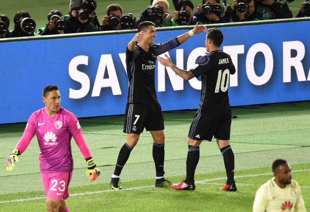 Real Madrid's forward Cristiano Ronaldo (2nd L) is congratulated by teammate James Rodriguez (#10) after scoring a goal during the Club World Cup semi-final football match between Mexico's Club America and Spain's Real Madrid at Yokohama International stadium in Yokohama on December 15, 2016. / AFP / TORU YAMANAKA (Photo credit should read TORU YAMANAKA/AFP/Getty Images)