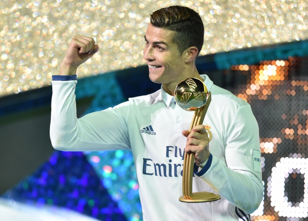 Real Madrid forward Cristiano Ronaldo receives the Golden Ball trophy after winning the Club World Cup football final match between Kashima Antlers of Japan and Real Madrid of Spain at Yokohama International stadium in Yokohama on December 18, 2016. (Photo by Kazuhiro Nogi/AFP/Getty Images)