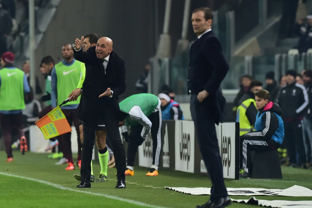 """Roma's coach Luciano Spalletti (L) reacts next to Juventus' coach from Italy Massimiliano Allegri during the Italian Serie A match Juventus vs AS Roma at """"Juventus Stadium"""" in Turin on January 24, 2016. (Photo by Giuseppe Cacace/AFP/Getty Images)"""