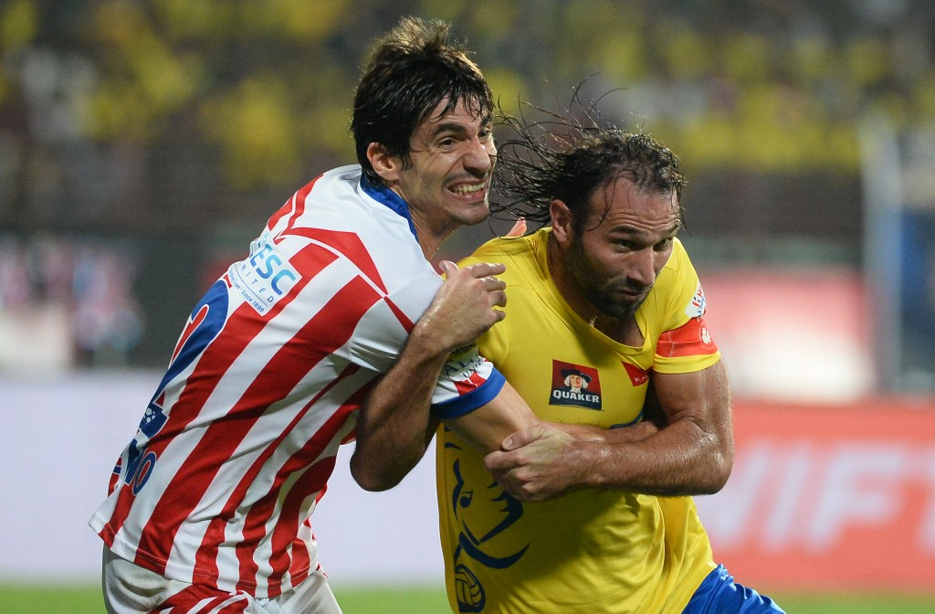 Kerala Blasters FC defender Cedric Hengbart (R) vies for the ball with Atletico de Kolkata defender Henrique Fonseca Sereno (L) during the final Indian Super League (ISL) football match between Kerala Blasters FC and Atletico de Kolkata at the Jawahar Lal Nehru Stadium in Kochi on December 18, 2016.   ----IMAGE RESTRICTED TO EDITORIAL USE - STRICTLY NO COMMERCIAL USE----- / AFP / SAJJAD HUSSAIN        (Photo credit should read SAJJAD HUSSAIN/AFP/Getty Images)
