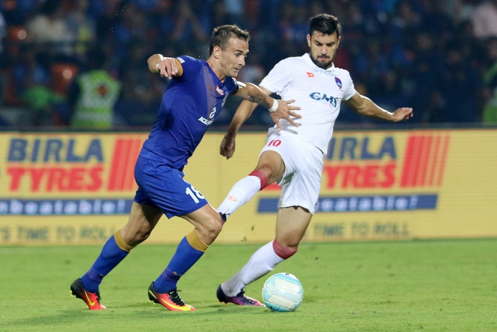 Lucian Goian of Mumbai City FC and Bruno Augusto Pelissari De Lima of Delhi Dynamos FC in action during match 55 of the Indian Super League (ISL) season 3 between Mumbai City FC and Delhi Dynamos FC held at the Mumbai Football Arena in Mumbai, India on the 3rd December 2016. Photo by Vipin Pawar / ISL / SPORTZPICS
