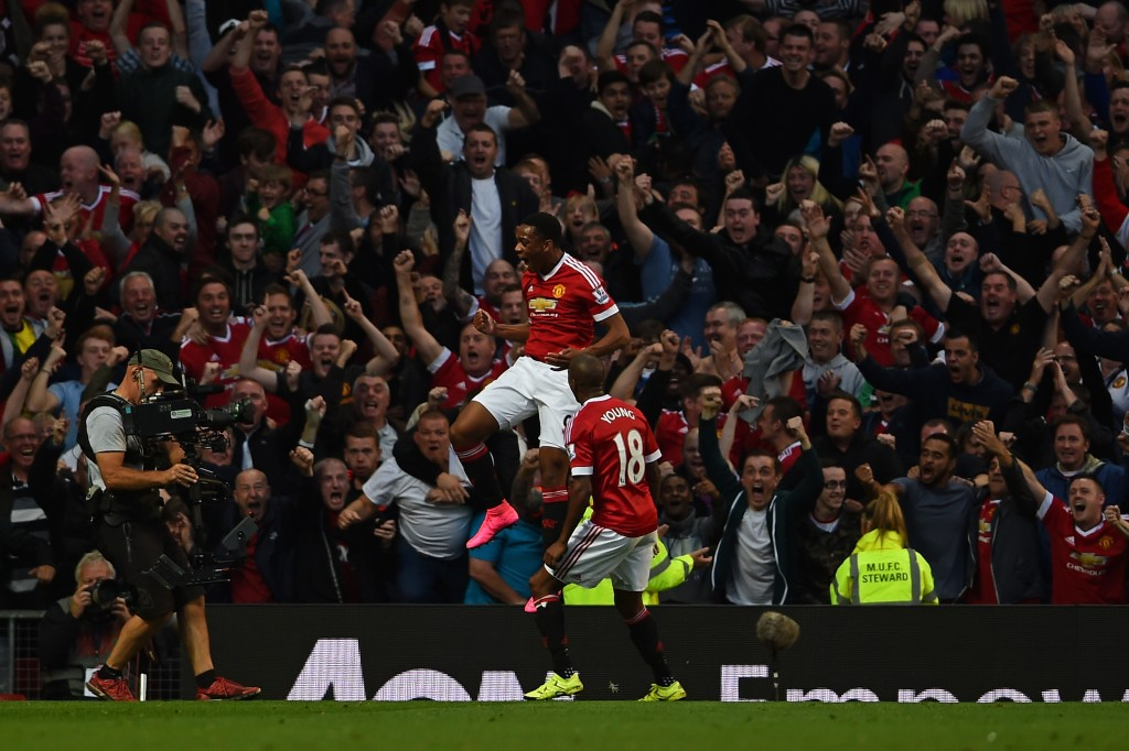 MANCHESTER, ENGLAND - SEPTEMBER 12: Anthony Martial of Manchester United celebrates scoring his team's third goal with Ashley Young during the Barclays Premier League match between Manchester United and Liverpool at Old Trafford on September 12, 2015 in Manchester, United Kingdom. (Photo by Laurence Griffiths/Getty Images)