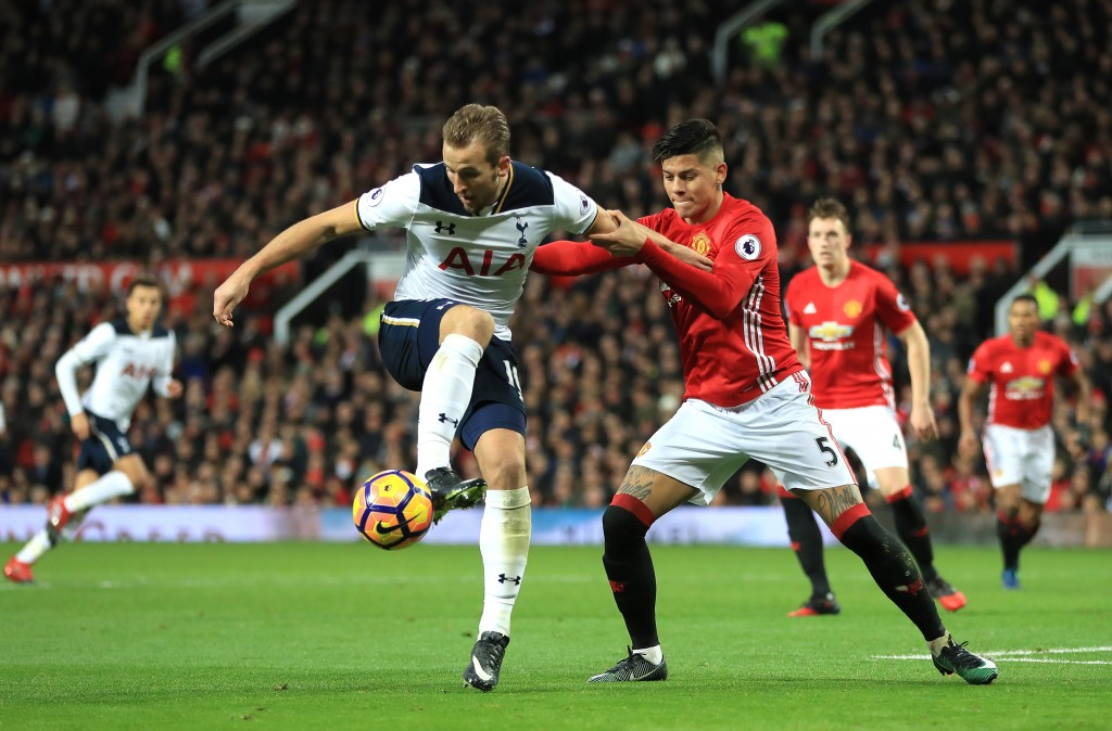 MANCHESTER, ENGLAND - DECEMBER 11: Harry Kane of Tottenham Hotspur controls the ball under pressure of Marcos Rojo of Manchester United during the Premier League match between Manchester United and Tottenham Hotspur at Old Trafford on December 11, 2016 in Manchester, England. (Photo by Richard Heathcote/Getty Images)