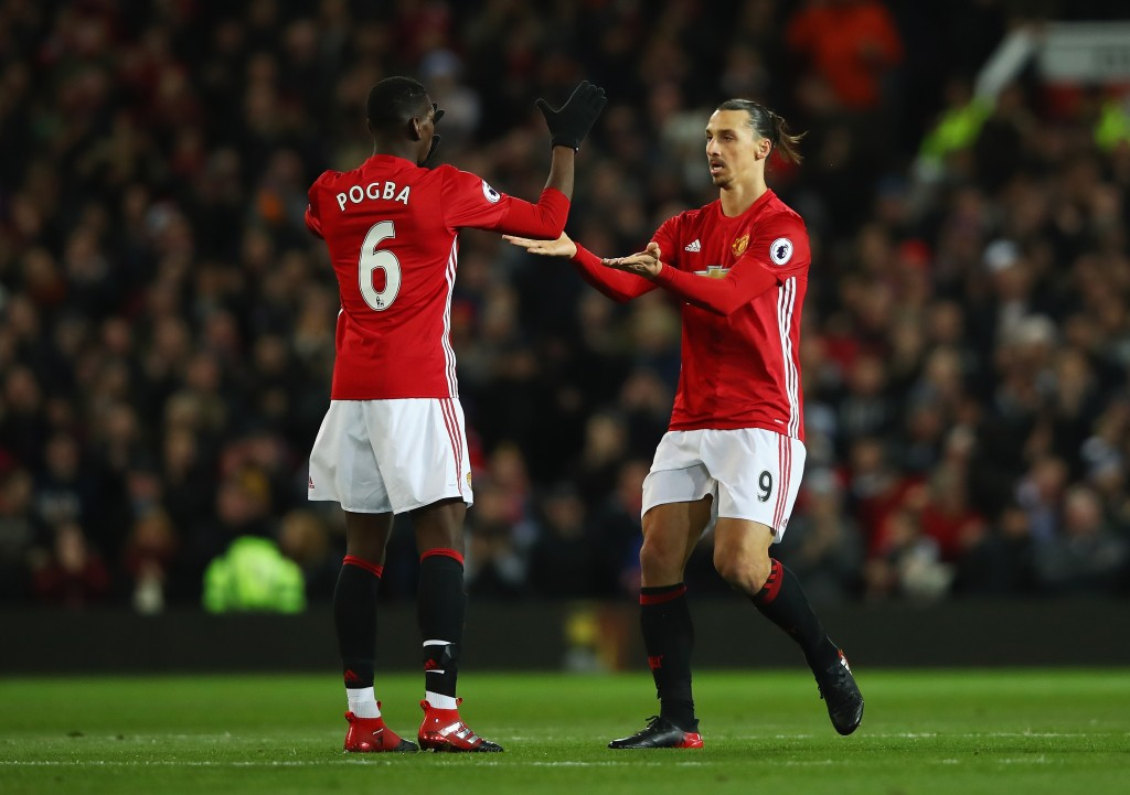 MANCHESTER, ENGLAND - NOVEMBER 27: Zlatan Ibrahimovic of Manchester United (R) celebrates scoring his sides first goal with Paul Pogba of Manchester United (L) during the Premier League match between Manchester United and West Ham United at Old Trafford on November 27, 2016 in Manchester, England. (Photo by Clive Brunskill/Getty Images)